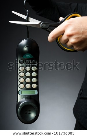 Woman's hand, cut off the phone with scissors (business-deprivation issue of communication) - stock photo