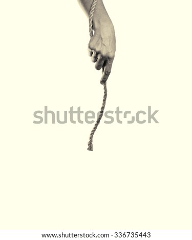 woman's hand hands a rope on toned background - stock photo