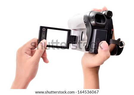 woman's hand holding a home video camera - stock photo