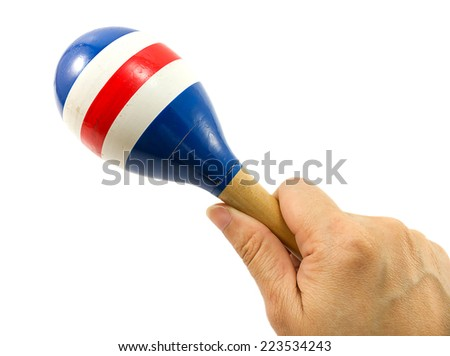 Woman's hand holding a maracas on  white isolate background. - stock photo
