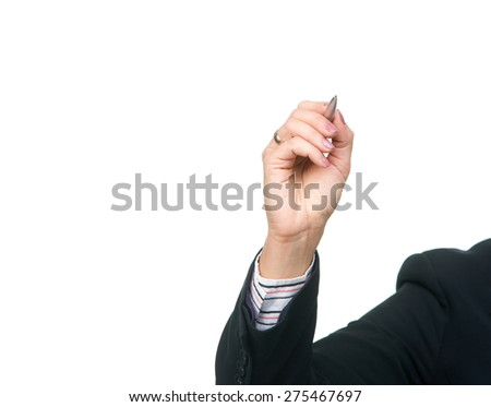 Woman's hand holding a silver pen writing something on empty space. Isolated over white background - stock photo