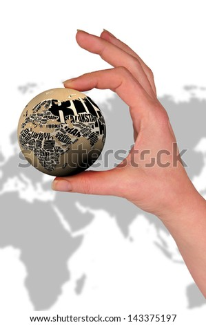 woman's hand, holding a terraqueous globe - stock photo