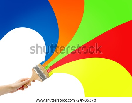 woman's hand holding big brush with different colors of paint;choosing colors - stock photo