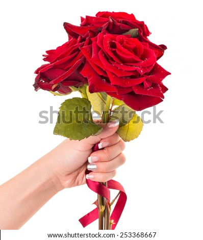 Woman's hand holding bouquet of three red roses, isolated on white. - stock photo
