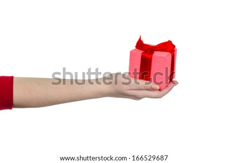 Woman's hand holding pink gift box with red ribbon isolated on w - stock photo