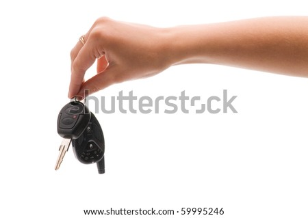 Woman's hand holds out key to the car. Isolated on white background. - stock photo