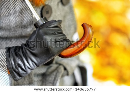 Woman's hand in the glove. Shallow DOF. Focus point on the hand. - stock photo
