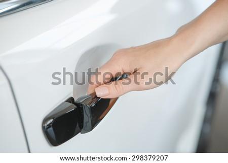 woman's hand open car door - stock photo