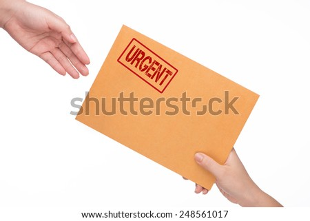 woman's hand passes the envelope male hand. yellow envelope in the hand isolated on white background. Urgent symbol. - stock photo