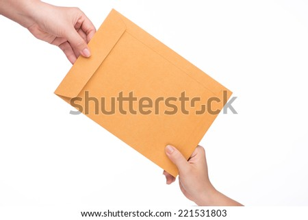 woman's hand passes the envelope male hand. yellow envelope in the hand isolated on white background - stock photo