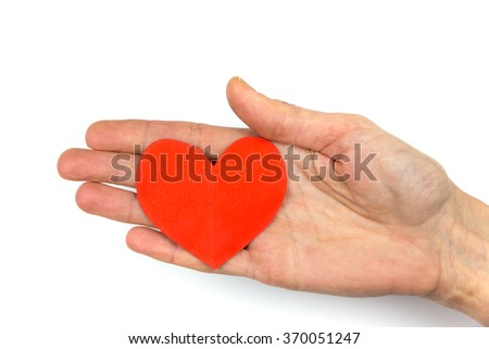 Woman's hand showing red paper heart isolated on white background as symbol of love - stock photo