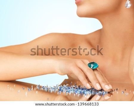 woman's hand with cocktail ring on the mirror - stock photo