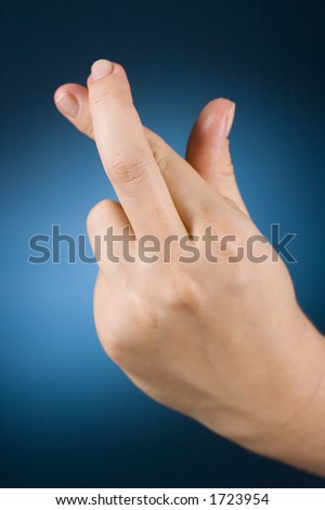 woman's hand with crossed fingers - stock photo