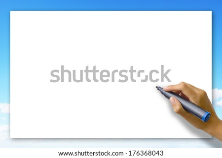 Woman's hand writing on a blank card  - stock photo