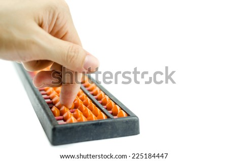 Woman's hands accounting with the old abacus on white background - stock photo