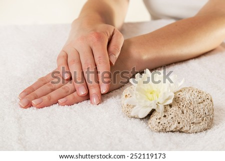 Woman's hands after a manicure in a nail salon - stock photo