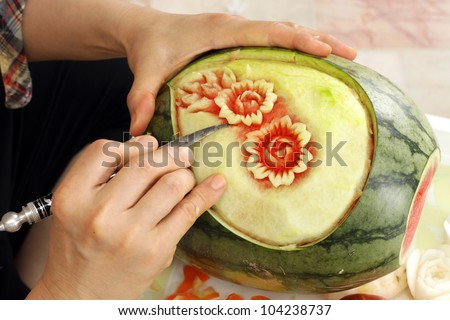 Woman s hands carved watermelon show step - stock photo