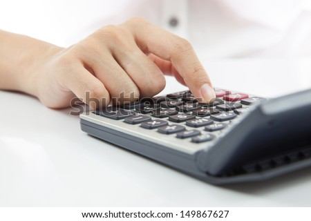 Woman's hands counts on the calculator - stock photo