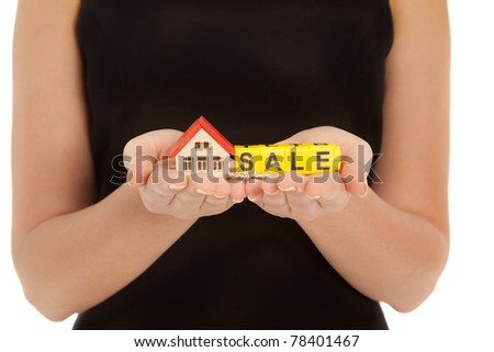 Woman's hands holding house and keys isolated on white - stock photo