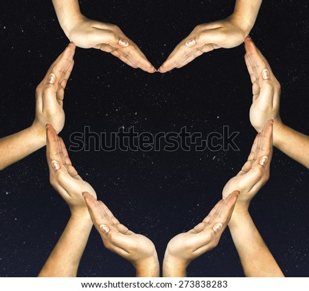 woman's hands make heart shape  - stock photo