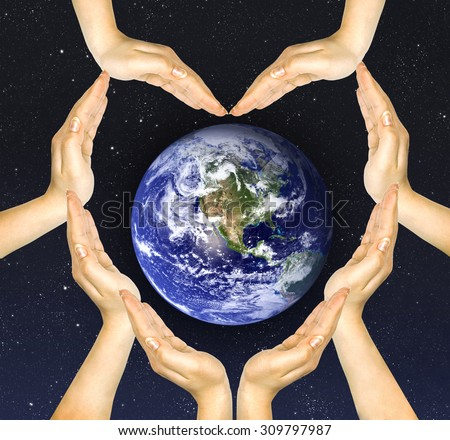 woman's hands make heart shape and earth inside. Elements of this image furnished by NASA - stock photo