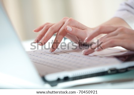 Woman's hands pressing keys on a laptop keyboard trying to access data - stock photo