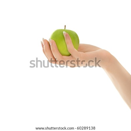 Woman's hands with green apple isolated on white - stock photo