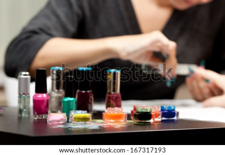 Woman's hands with nail file - stock photo