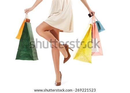 Woman's legs and Shopping Bags Isolated on White - stock photo