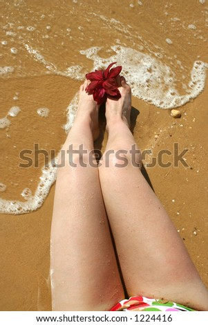woman's legs by the seashore - stock photo