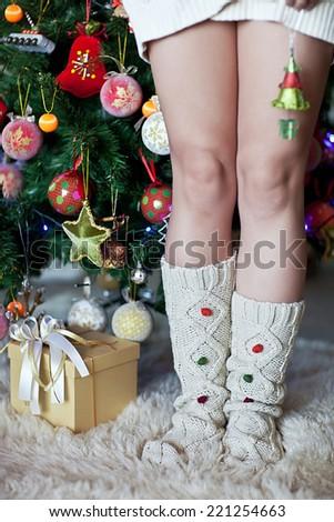woman's legs in wool christmas socks - stock photo