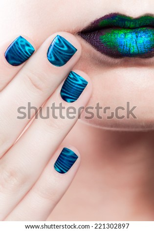 Woman's lips with beautiful multicolor holographic Minx nails and bright colorful make-up - stock photo