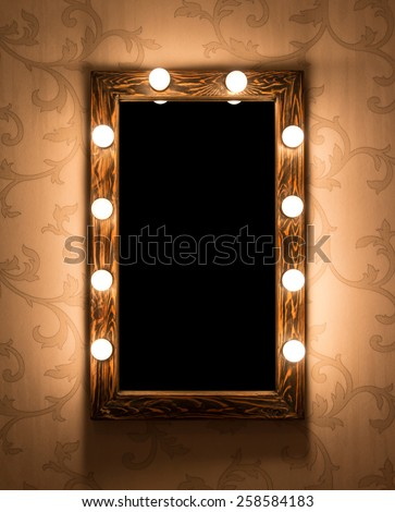 Woman's makeup place with mirror and bulbs - stock photo