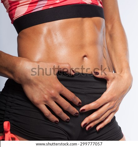 Woman's muscular stomach, perfect abs - stock photo