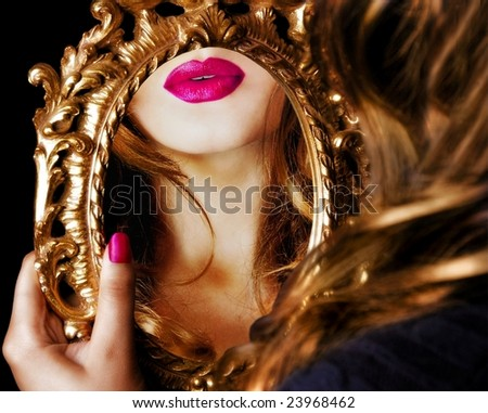 Woman's reflection in mirror - stock photo