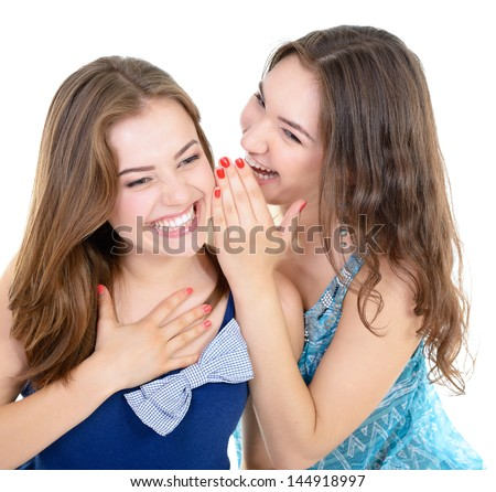 woman's secret, two young beautiful women friends whisper funny news - stock photo