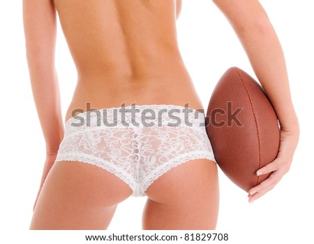 Woman's Sexy Backside Holding a Football wearing Lace Lingerie Panties - stock photo