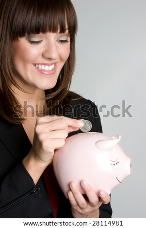 Woman Saving Money - stock photo