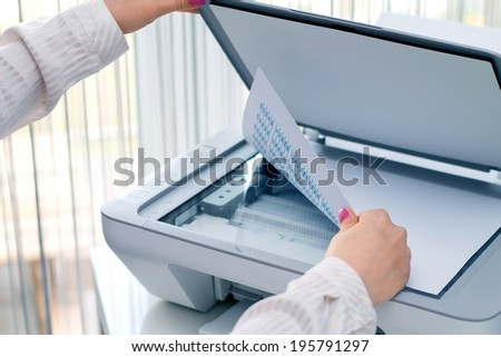 Woman scan some documents at work - stock photo