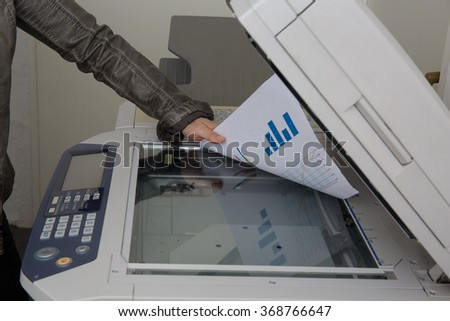 Woman scan some documents at work on a copy machine - stock photo