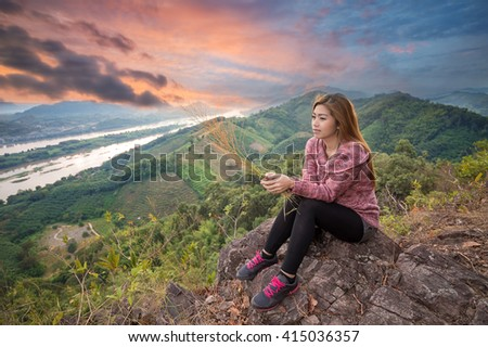 Woman scenic ride on the cliff of twilight - stock photo