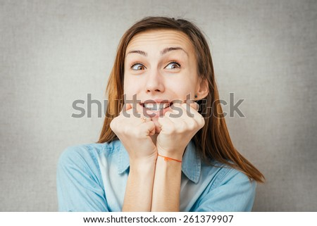 woman screaming because of winning excitement - stock photo