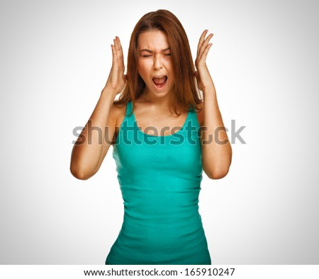 woman screaming wild hair her opened mouth hands to his head emotion background - stock photo