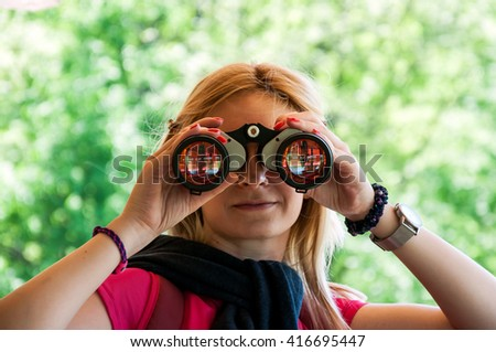 Woman searching birds in the birdhouse - stock photo