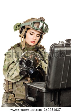 woman selects the gear before the battle - stock photo