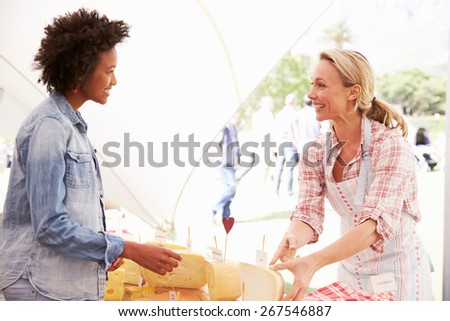 Woman Selling Fresh Cheese At Farmers Food Market - stock photo