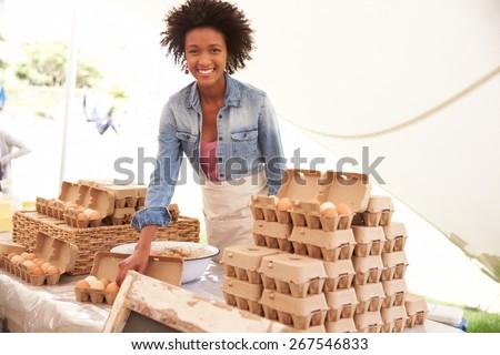 Woman Selling Fresh Eggs At Farmers Food Market - stock photo
