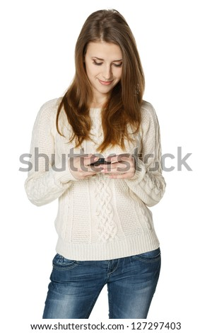 Woman sending a sms on cell phone, isolated on white background - stock photo