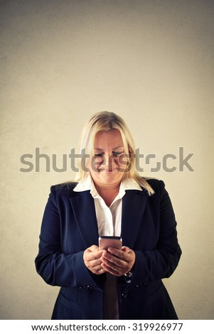 Woman sending a text message - stock photo