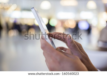 Woman sending messages with her mobile phone - stock photo